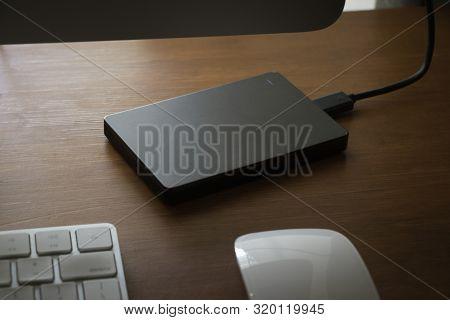 A Mobile Backup Hard Drive Sitting On A Desktop