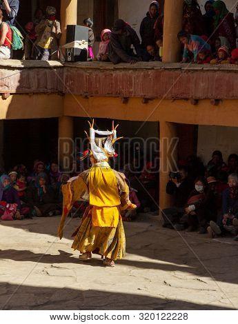 Korzok, Ladakh, India - July 23, 2012: Unidentified Monk In Garuda Mask (bird-like Creature In Hindu