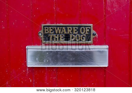 Beware Of Dog Sign On Front Gate Of House Above Letter Box