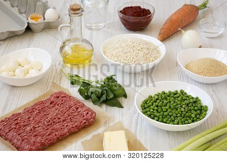 Ingredients For Cooking Arancini On A White Wooden Surface, Low Angle View.