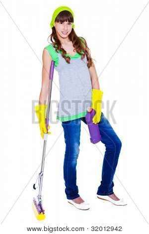 Smiling teen with detergent and mop