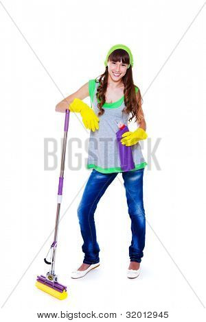 Smiling teenage girl standing with mop and cleanser