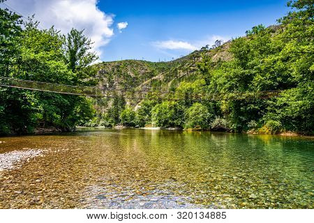 Tiny Wooden And Cable Bridge Above Crystal Clear Water In River Neretva In Village Ladanica, Bosnia