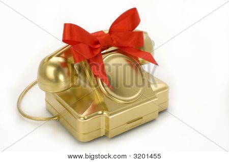 The Telephone Of Gold Colour With A Red Tape.