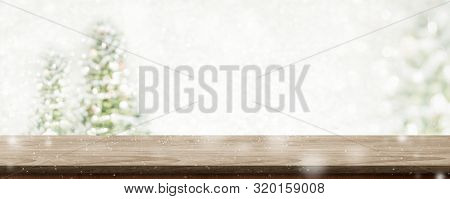Christmas Wood Table Top At Blur Bokeh Christmas Tree Decor With String Light Background,winter Holi