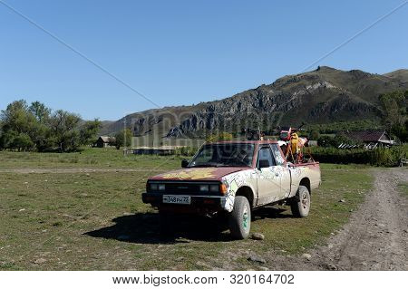 Altai Region, Russia - September 6, 2018:japanese Datsun Pickup Truck 720 In A Mountain Village Chin