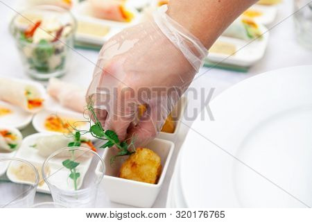 Closeup Catering Chef In Transparent Rubber Glove Put Appetizers In Sauceboats, Fried Brie Cheese, C