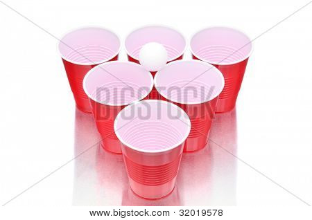 Ping Pong ball with cups for playing Beer Pong on a white background with reflection.