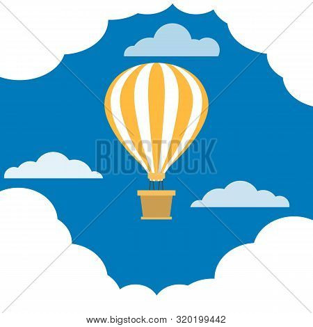 Hot Air Balloon With Basket Is Flying. Balloon Dome With White And Yellow Stripes. Blue Sky With Clo