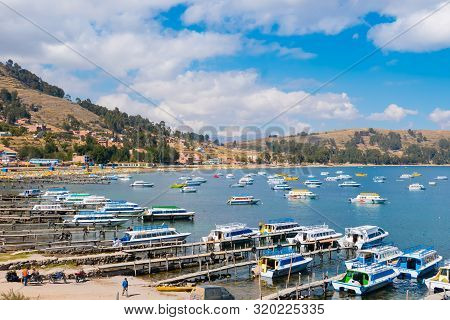 Titicaca Lake Peru, August 16 Boats At The Marina Of Copacabana That Bring Tourists To Visit The Isl