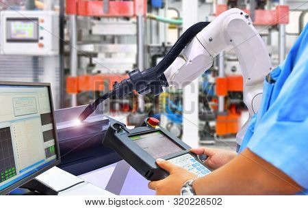 Engineer Check And Control Modern High Quality Automation Welding White Robots Arm At Industrial