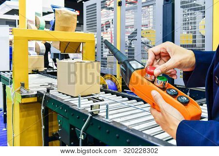 Manager Check And Control Automation Cardboard Boxes On Conveyor Belt In Distribution Warehouse.