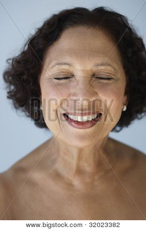 Senior African woman with eyes closed