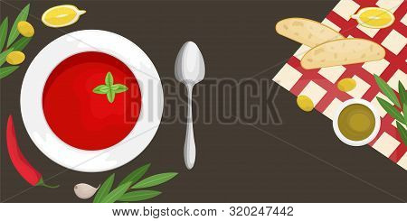 Gazpacho Soup In A Plate With Slices Of Ciabatta, Chili, Olive Oil And Olives, Cherry Tomatoes. Flat
