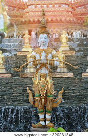 Beautiful Thai Traditional Angel Statue Stand Outside  With Hands Together.