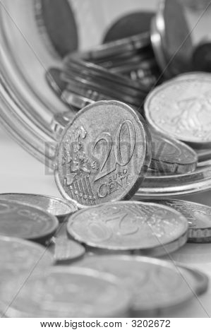 Euro Cents Rolling Out Of Pot.