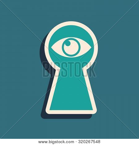 Green Keyhole With Eye Icon Isolated On Blue Background. The Eye Looks Into The Keyhole. Keyhole Eye