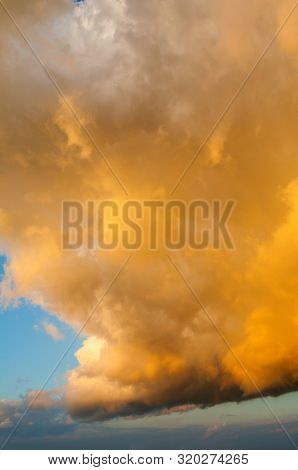 Orange dramatic sky background - picturesque sky colorful clouds lit by sunlight. Vast sky landscape panoramic scene, colorful sky view