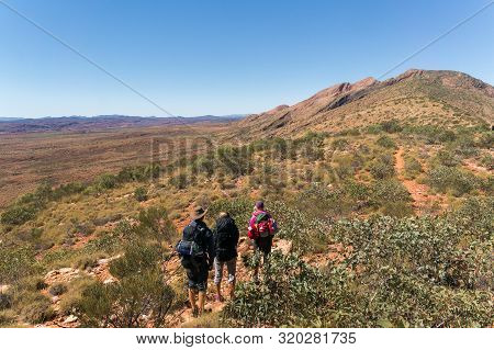 A Group Of Hikers On The Way To The Top Of Mount Sonder Just Outside Alice Springs, West Macdonnel N