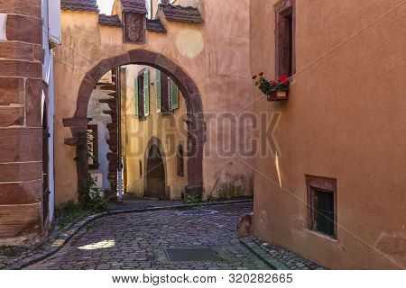Medieval Small Town Kaysersberg , Region Alsace. France. Narrow Street Of Old Town With Colorful Sto