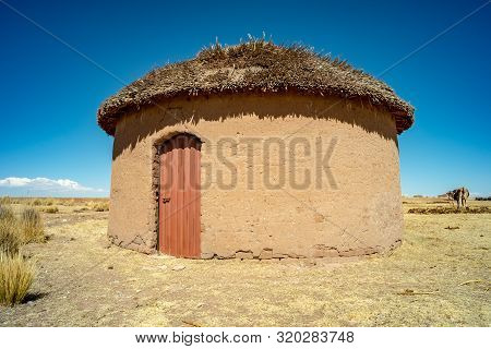 Rustic Traditional Uru House Made Of  Adobes In The Bolivian Altiplano
