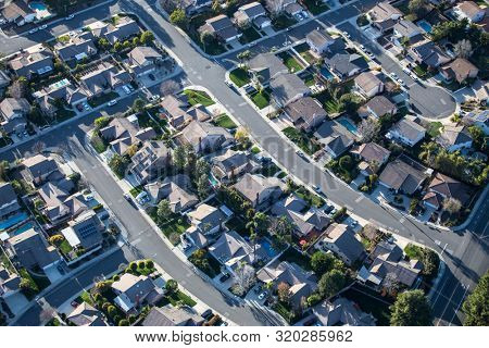 Aerial view of suburban Thousand Oaks homes and streets near Los Angeles in Ventura County, California.