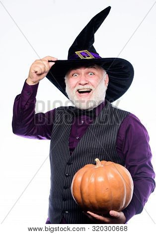 Halloween Party Traditions.Halloween Traditions Evil Wizard Hold Orange Pumpkin Bearded Man Ready For Halloween Party Stargazer In Holiday Costume Traditional Food Happy Halloween Mature Man Magician In Witch Hat Poster Id 320300668