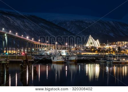 Tromso Harbour And Arctic Cathedral At Night, Norway
