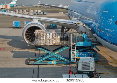 AMSTERDAM, THE NETHERLANDS - MAY 15, 2019: Cargo loaded into a KLM aircraft at Amsterdam Schipol International Airport