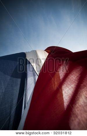 Dutch wrinkled flag against sun