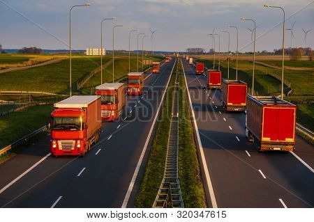 Red Trucks On The Express Way In A Beautiful Evening Light