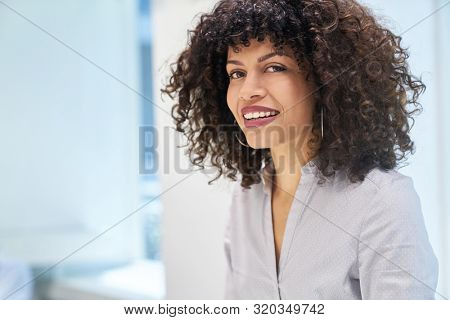 Young dynamic woman as a career woman or trainee in business company