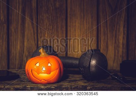 Happy Halloween Festival Background Concept. Close Up Of Halloween Head Pumpkins Doll And The Black