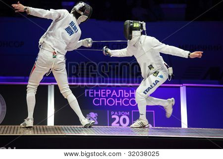 KIEV, UKRAINE - APRIL 14, 2012: Fight between Andras Redli, Hungary, and Matthew Trager, Italy, during World Fencing Championship on April 14, 2012 in Kiev, Ukraine