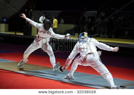 KIEV, UKRAINE - APRIL 14, 2012: Fight between Francesco Martinelli, Italy, and Gauthier Grumier, France during World Fencing Championship on April 14, 2012 in Kiev, Ukraine