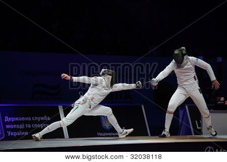 KIEV, UKRAINE - APRIL 14, 2012: Fight between Geza Imre, Hungary, and Enrico Garozzo, Italy, during World Fencing Championship on April 14, 2012 in Kiev, Ukraine
