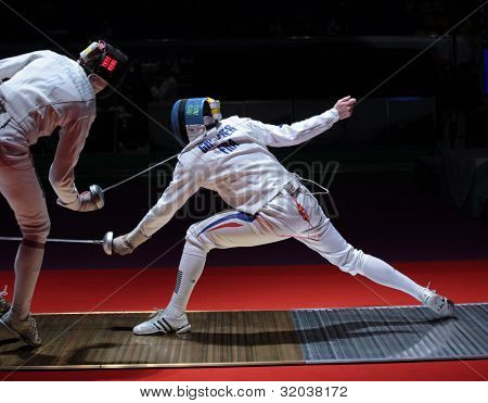 KIEV, UKRAINE - APRIL 14, 2012: Fight between Diego Confalonieri, Italy and Gauthier Grumier, France during World Fencing Championship on April 14, 2012 in Kiev, Ukraine