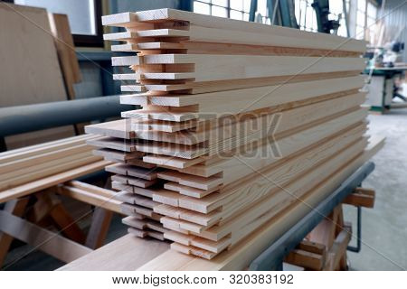 Parts of wooden windows from glued beams from pine with chopped mortise and tenon joints. Close up view, selective focus. poster