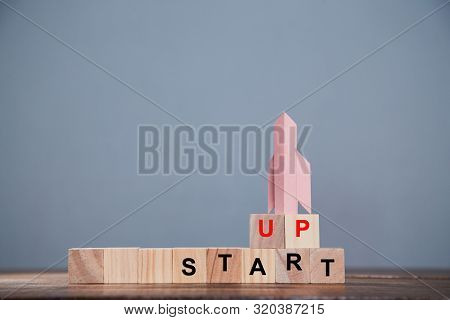 Startup And Aspirations. New Business, Development And Investment Concept. Wooden Cubes For Labels A