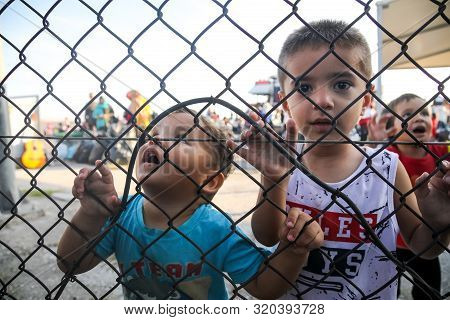 Refugee Children Disembark In The Port Of Thessaloniki After Being Transfered From The Refugee Camp