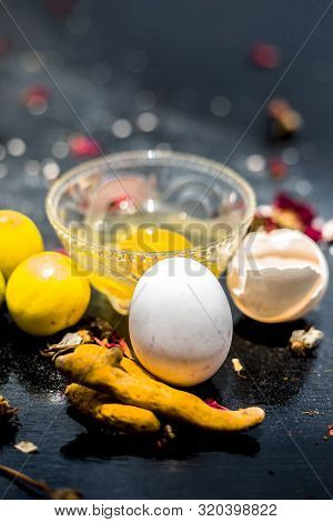 Face Mask Of Lemon Juice, Honey, And Curd Along With Some Raw Turmeric Well Mixed In A Glass Bowl Al