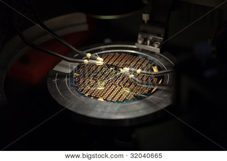 Isometric perspective of a beautiful microchip under test probes.