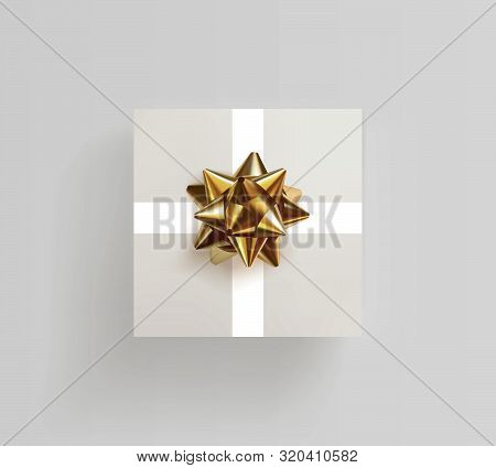 Decorative White Gift Box With Realistic Golden Bow. Top View. Celebration Decoration For Birthday,