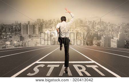 Businessman Jumping On A Starting Grid With Cityscape On The Background. Caucasian Man, Empoyer In S