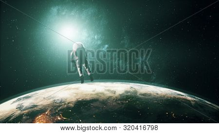 Astronaut in white spacesuit flies in outer space over illuminated planet Earth backside view. 3d animation computer graph. Science and technology concept. Elements of this media furnished by NASA