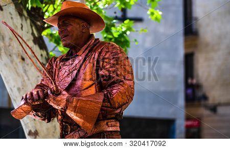 Barcelona, Spain – 2019. Man Dressed As Cowboy Gives Live Statue Performance At Famous La Rambla Str