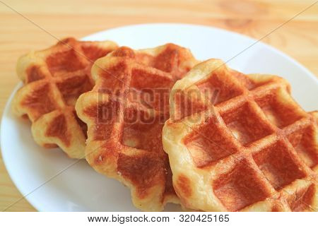 Closeup Delectable Belgian Waffles Served On A White Plate