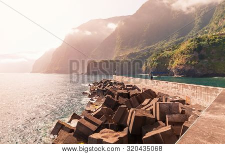 Seixal Pier. Coastal Landscape Of Madeira Island At Sunset, Portugal