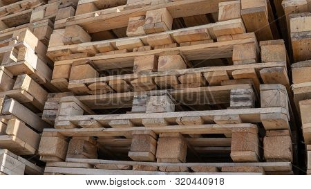 Wooden Euro Pallets For Transfering Goods To Customers. Used Wooden Pallets In Stack In The Warehous