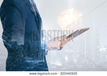 Concept Network Of Business : Young Businessman Standing And Holding A Tablet With The Icon Of The W